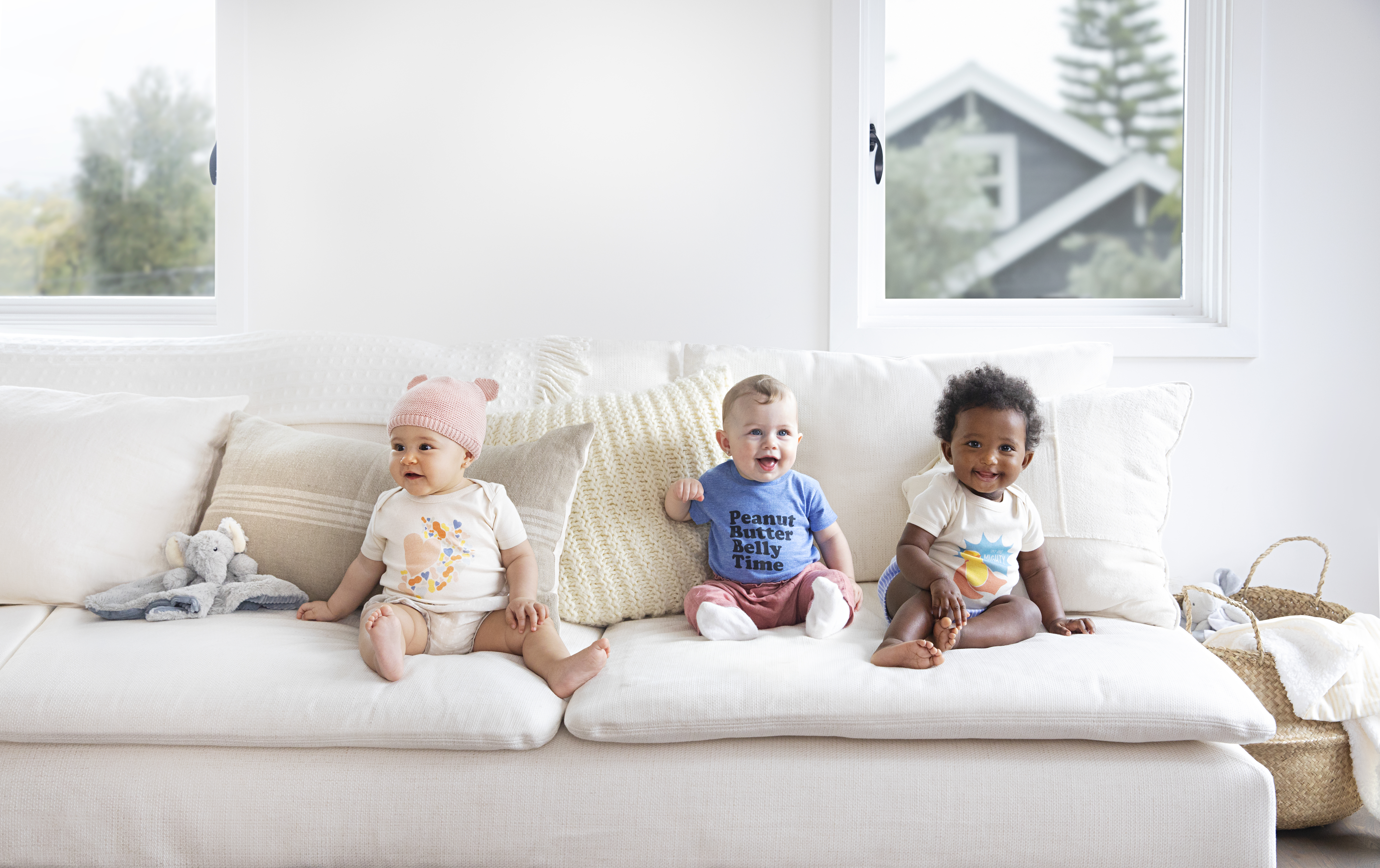 3 babies on a couch